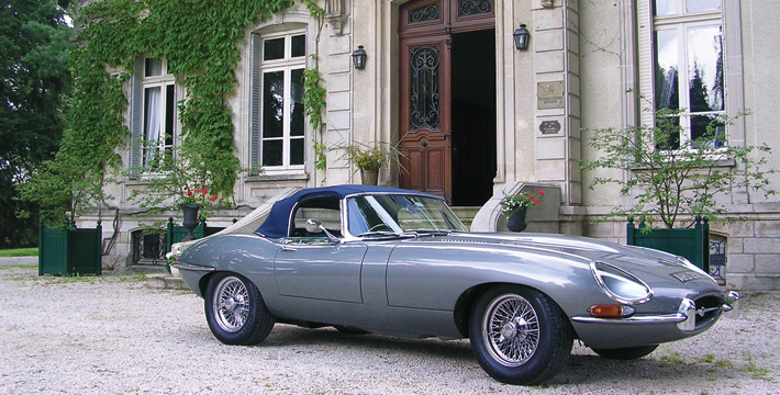 Jaguar E-Type pictured in front of a chateau