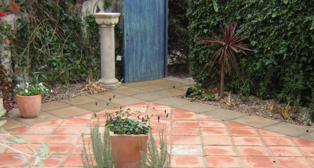 The fact that the garden was enclosed by walls lent itself to a courtyard style garden and we enhanced this further by using terracotta tiles for a touch of the Mediterranean.