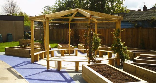 A large octagonal pergola with built-in benches was constructed as a pleasant outdoor 'classroom' with scented climbers providing shade.