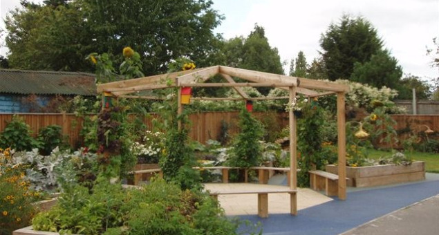 "The ""Outdoor Classroom"" was finished and Floral and Hardy handed over the completed garden to the school. The teachers had now become involved; all classes from years 3 to year 6 chose a raised bed each and the gardening club commenced at lunchtimes."