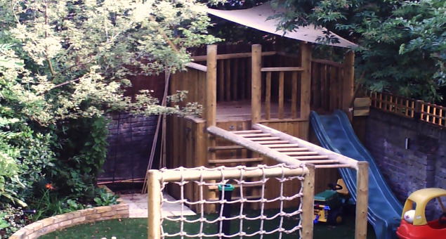For the children an exciting bespoke play structure was constructed to the rear of the garden with practical storage built-in underneath.