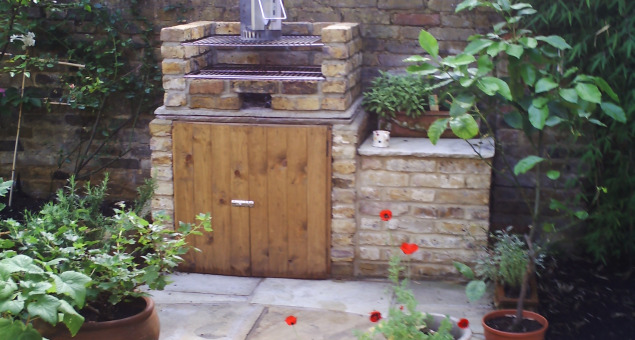 The large patio area was laid to natural sandstone and a barbecue was built-in for entertaining.