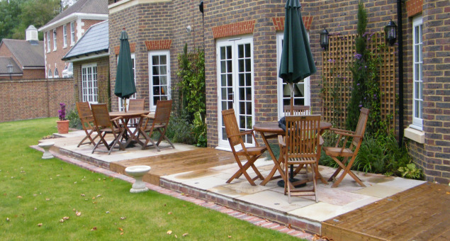 Much more space for relaxing and entertaining was also achieved by continuing the hard landscaping between the three sets of patio doors.