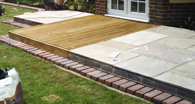 The gardens were given interest by introducing a mix of materials, using a combination of natural sandstone with red brick edging to match the building, and timber decking.