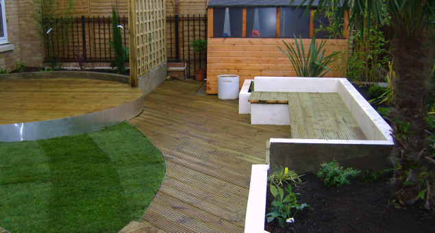 Our clients wanted to transform this urban wasteland into a low maintenance outside space where they could entertain, party and relax. They wanted some greenery, including a small lawn and plenty of colour. The requested lawn was incorporated into the plan and provides a pool of green to break up the decking.