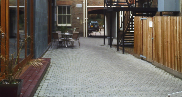 An uninspiring decked area surrounded by dull grey granite sett paving, with overgrown planting in a single raised bed hardly reflected the efforts made inside to make this a welcoming destination.