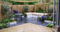 image of a modern patio and decking in the design of outside room garden