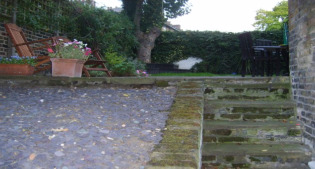 before image of glass balustrade garden before