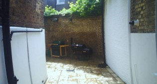 before image of the transformed courtyard garden
