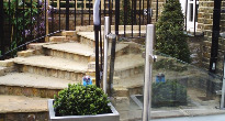 Paved garden with glass balustrades