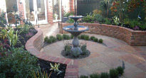 courtyard with raised planting and water feature