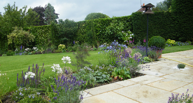 Our clients wanted to create a traditional country-style garden with lots of colour and traditional features.