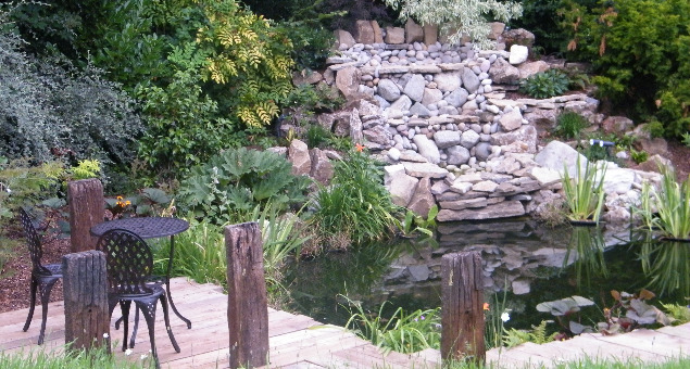 The pond was re-constructed with the addition of a large, cascading waterfall, bog gardens and much more interesting planting. A rustic boardwalk and jetty was also added to provide somewhere to sit and watch the wildlife.