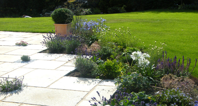 Small gaps were left in the paving for herbs and other creeping plants to release their scents when stepped upon.
