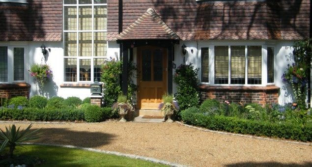The front garden was transformed with a more formal treatment of low box hedging enclosing more colourful traditional planting, to provide an altogether more imposing and welcoming approach to the property.