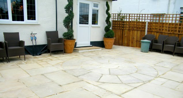 The old crazy paving was replaced with a deeper, curving patio constructed with creamy-buff natural sandstone, providing a much more useable seating area.