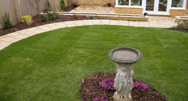 The new garden incorporates curves and changes of levels to add interest to the rather angular plot