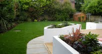 family garden with raised rendered planters