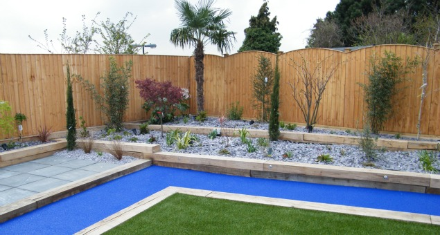 The planting was contained in raised beds constructed with new oak sleepers which will, together with the new fences, slowly weather down over time to a soft, silvery grey, complementing the grey slate and blue path wonderfully.