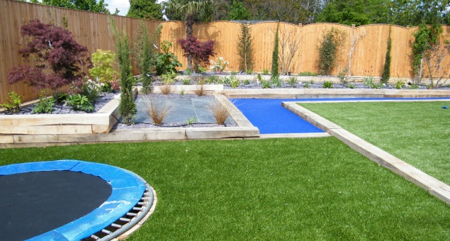 Our clients were keen to use artificial turf as a play surface as, once laid, it involves virtually no maintenance, therefore no need for fuel guzzling lawn mowers, and of course - it means no mud in the house!  I think you'll agree you can't really see the difference from the real thing.