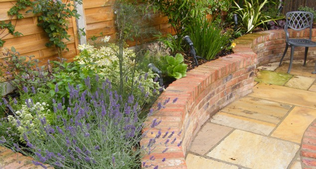 The planting scheme is fairly traditional with plenty of Lavender, Clematis, Roses, herbs and espalier fruit trees included, and also designed with birds and insects in mind as our clients were keen to encourage them into the garden.