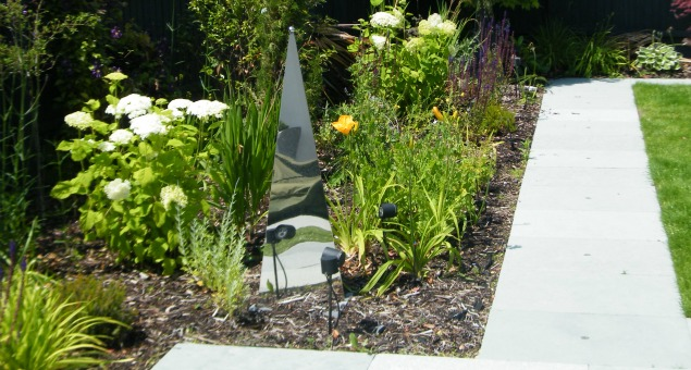 Planting around one of the reflective pyramids