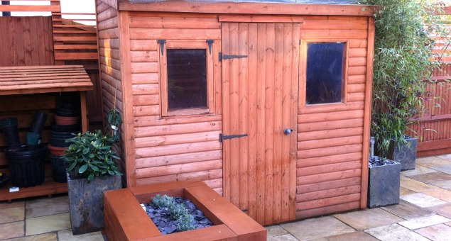 Our clients wanted to keep their shed, although we gave it a new position.