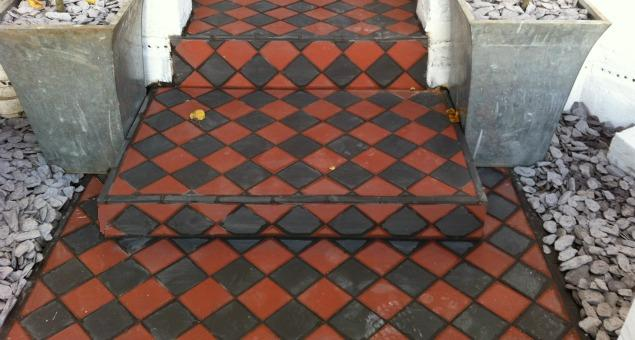 We restored the look of the old path by replacing the broken red and black tiles with new ones, but in the Victorian style.