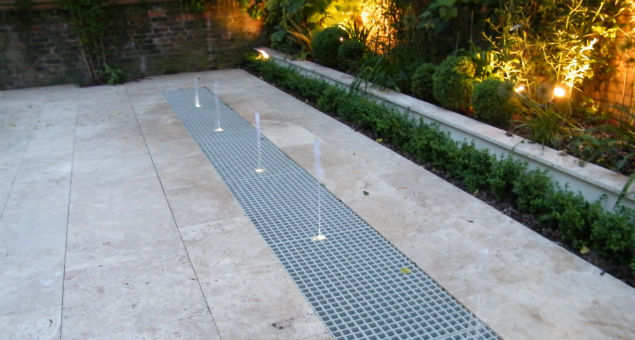 The upper rill water feature with the jets uplit at night for a fabulous effect