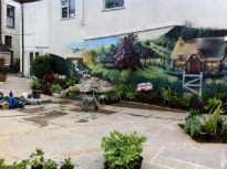 picture of original mural with water feature in front