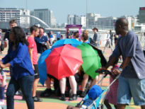 picture of miniature 'tube train' of umbrellas