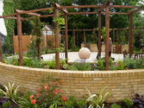 picture of raised beds and central water feature