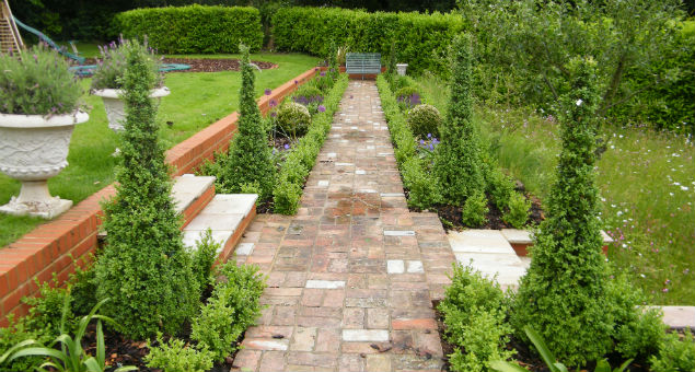 The formal garden where we used the red bricks from the original terrace to form the new path
