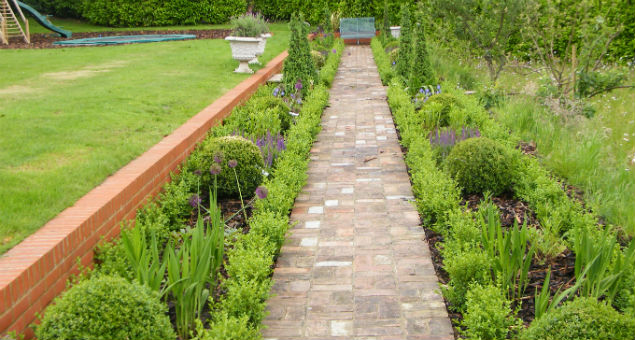 View along the formal garden showing the new path made from the original red bricks that we lifted from the terrace.