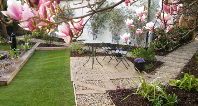 The lower seating area through the magnolia