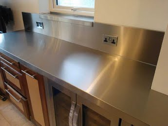 Genial Stainless Steel Worktop With Welded Sink And Splashbacks. Integrated  Lighting Mounted On Top And Behind Splashback.