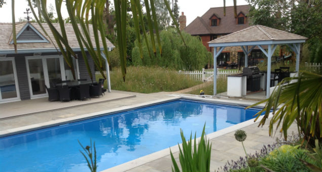 Pool, summerhouse and BBQ with the house in the background