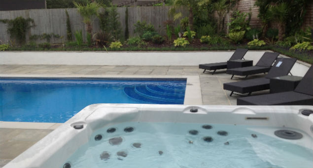 View over the newly installed hot tub to the pool