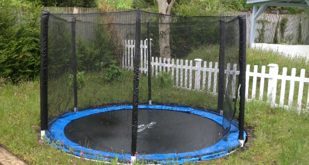 The sunken trampoline next to the children's play area