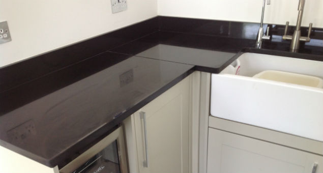 The kitchen work tops are granite and there is a wine fridge underneath for the owners' enjoyment
