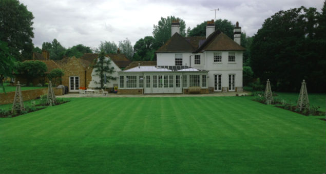 Looking back at the house across the new croquet lawn