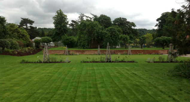 The planting beds are symmetrical and the gaps between line up with the steps to the upper part of the garden