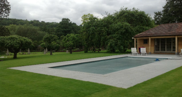 The original pool but with newly laid lawn