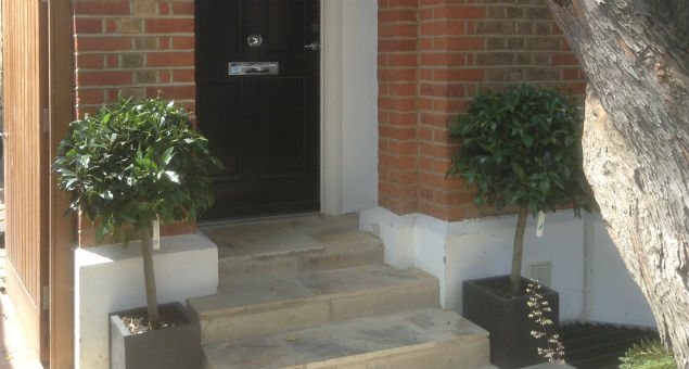 Detail of the new steps to the front door showing the fossils embedded in the beautiful sandstone