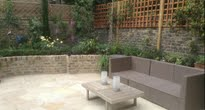 Rear patio garden with raised planting beds