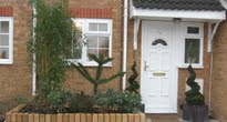 Front garden to a terraced house in Carshalton with a small garden at the rear built to be dog friendly