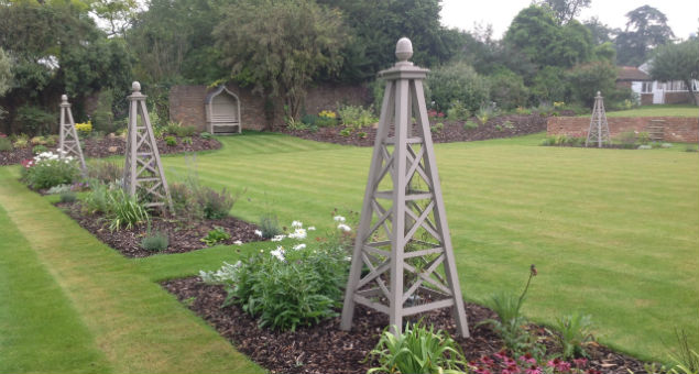 Obelisks edge the croquet lawn and are lit up at night
