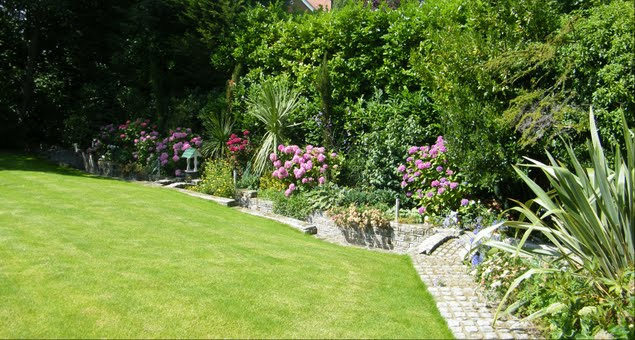 The new colourful borders in flower with the foliage plants giving definition to the beds