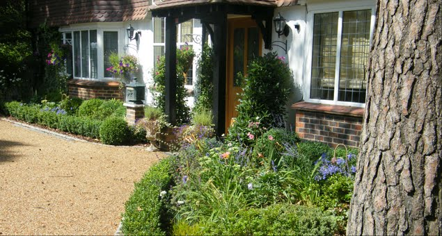 The planting bed to the right of the front door