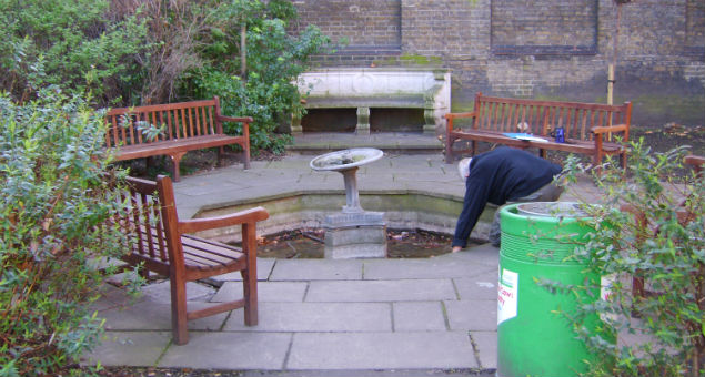 The paved area within the school gardens contained a defunct, and rather bent, lead fountain in an octagonal pond.